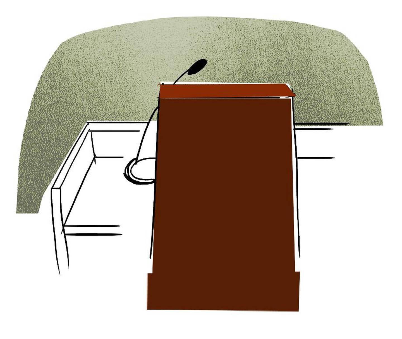 Bildet er av en stol bak en pult. Det er en tiltalebenk.