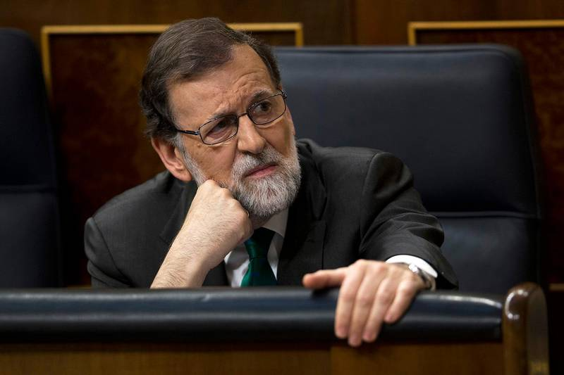Spain's Prime Minister Mariano Rajoy and Popular Party leader listens to speeches during the first day of a motion of no confidence session at the Spanish parliament in Madrid, Thursday, May 31, 2018. The lower house of the Spanish parliament is debating whether to end Prime Minister Mariano Rajoy's close to eight years in power and supplant him with the leader of the Socialist opposition. (AP Photo/Francisco Seco)
