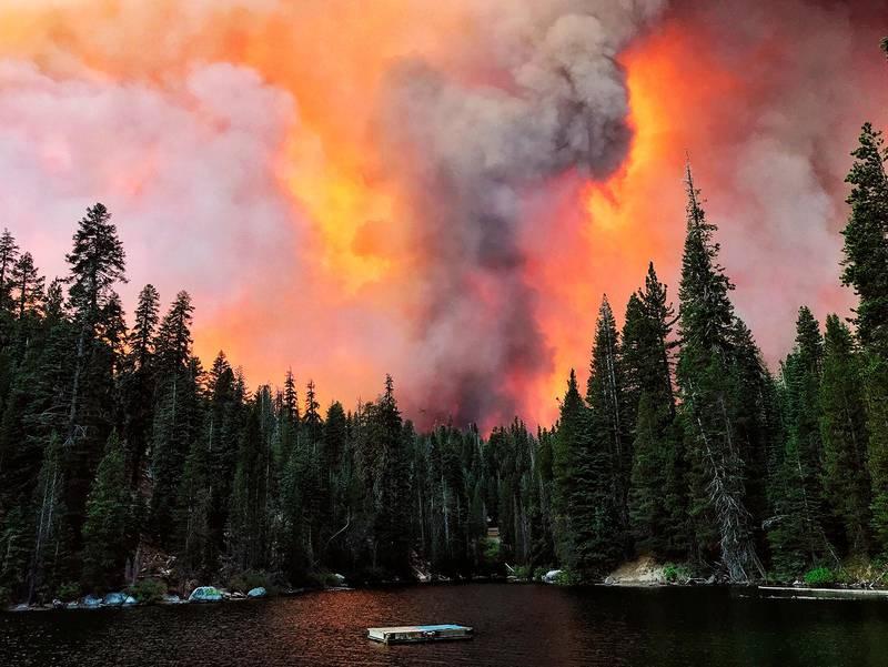 Smoke from the Creek Fire billows beyond a ridge as seen from Huntington Lake on Saturday, Sept. 5, 2020, at Huntington Lake, Calif. (Eric Paul Zamora/The Fresno Bee via AP)