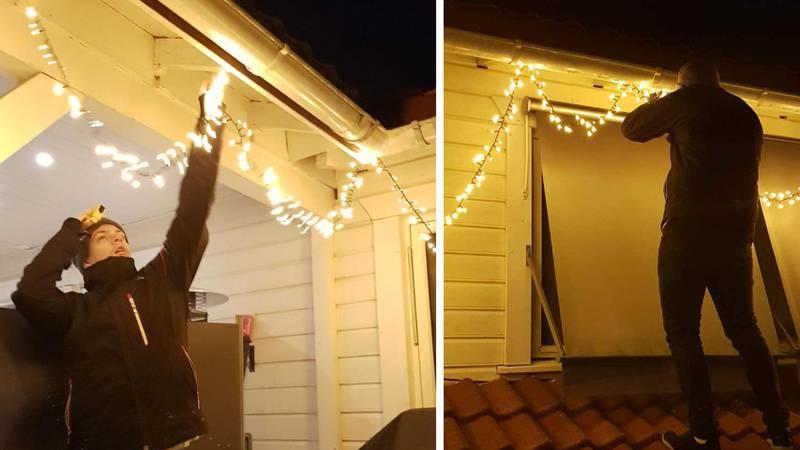 Bildet viser en mann som henger opp lyslenker.